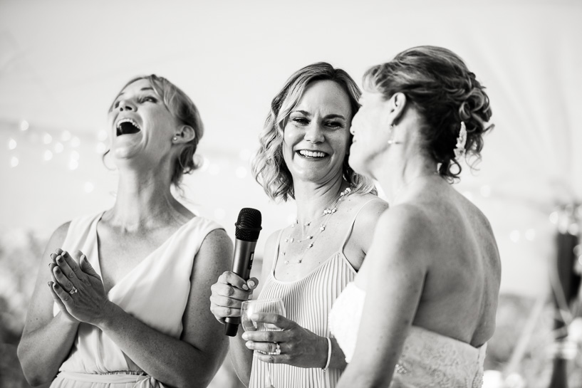 Sisters toast bride at backyard wedding