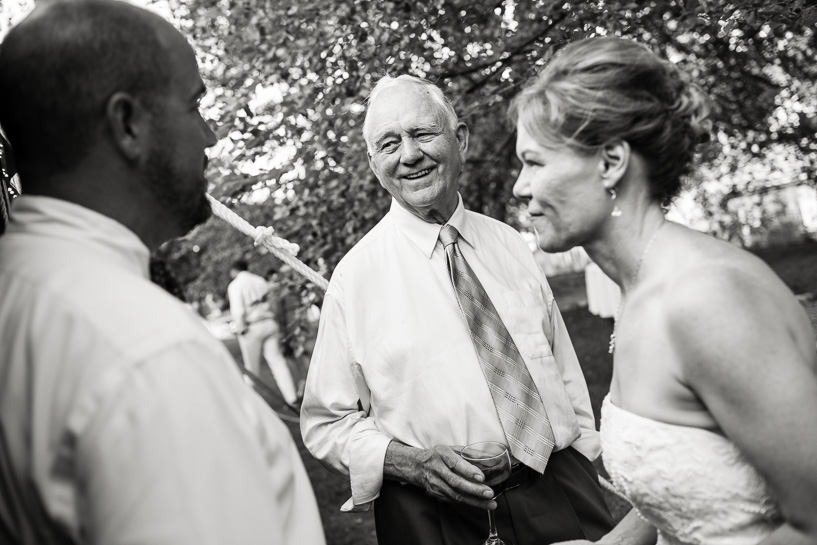 Couple with bride's father by Denver wedding photojournalist