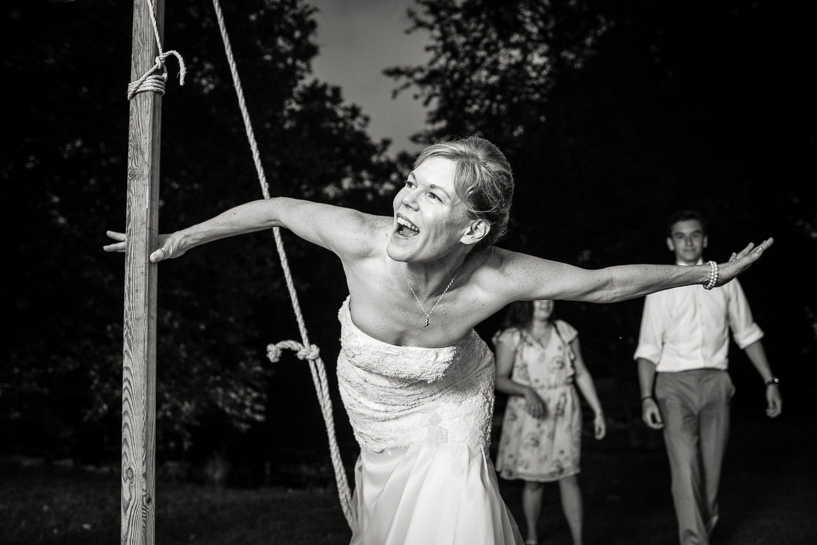 Wild bride dancing by black and white Denver wedding photographer