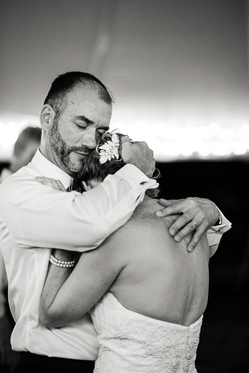 Denver wedding photographer captures groom and bride in tight embrace
