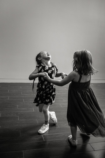 Girls dancing by Denver wedding photographer.