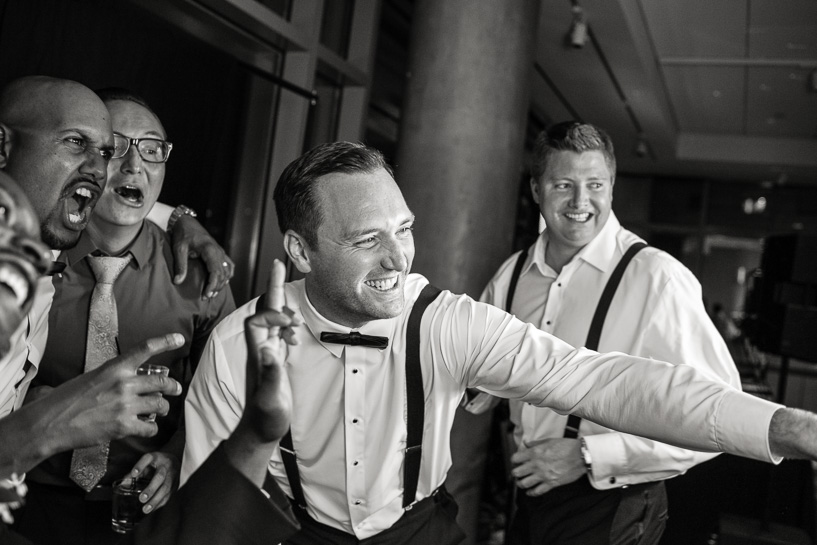 Groom and best men dance at Denver wedding reception.