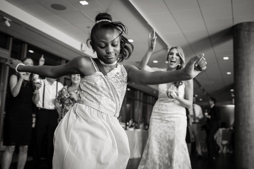 Flower girl dances at Denver wedding.