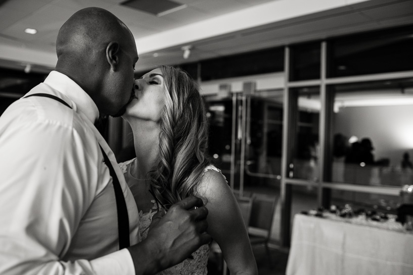 Bride and groom kiss at History Center Colorado wedding reception.
