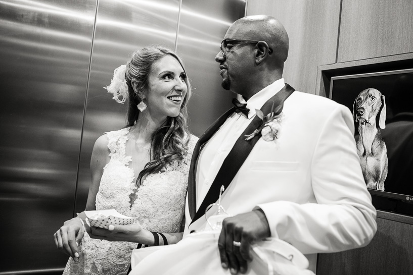 Bride and groom in elevator at the Art hotel in Denver.