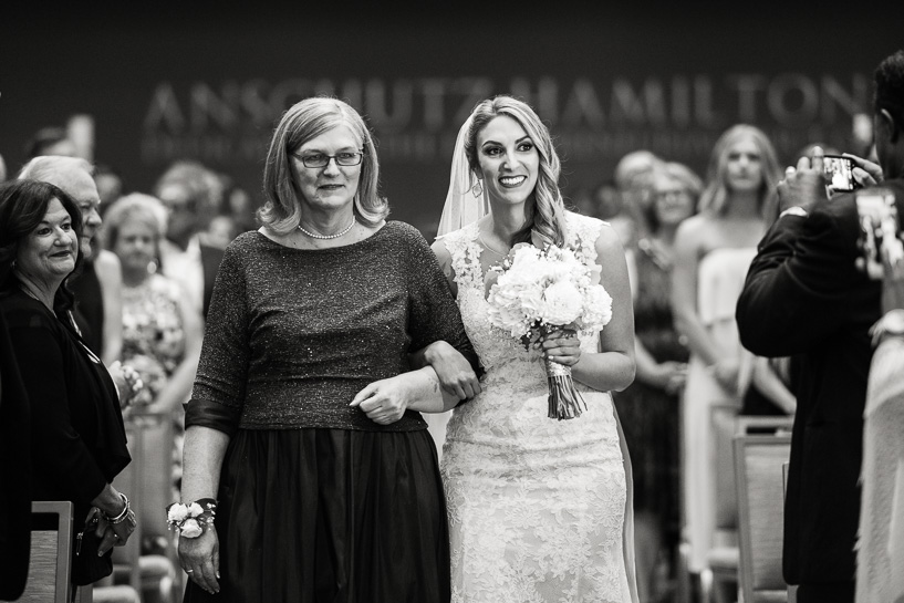 Bride and mother walk down aisle at History Center Colorado wedding.