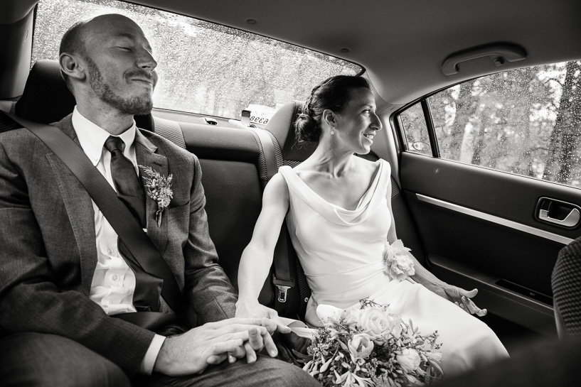 Bride and groom in the back seat following a Boulder, Colorado wedding.