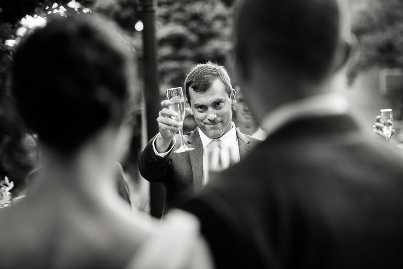 Denver wedding photojournalist captures best man toasting couple at Chautauqua Community Hall wedding.