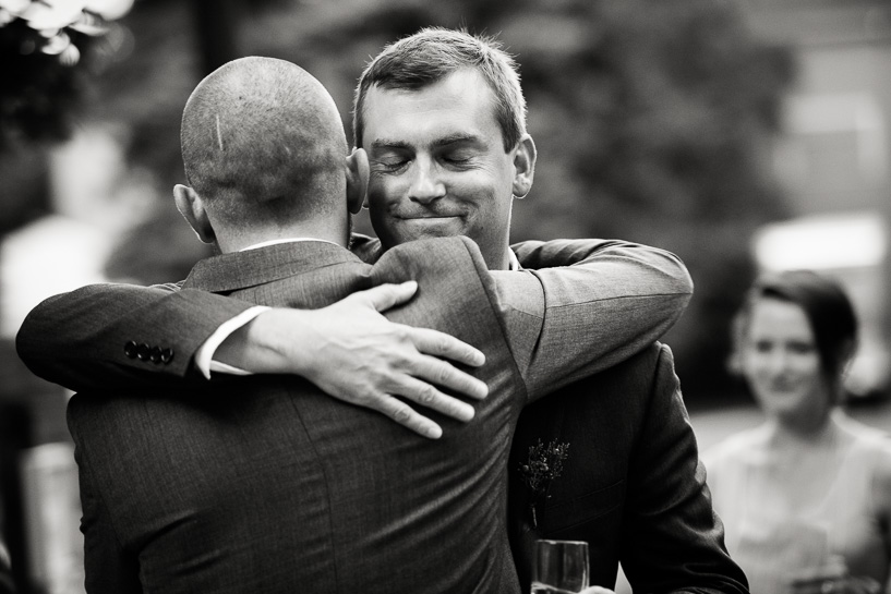 Denver wedding photojournalist captures best man and groom at Chautauqua Community Hall wedding.