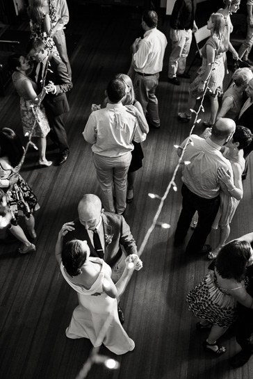 Overhead image of bride and groom dancing at Chautauqua Community House wedding reception.