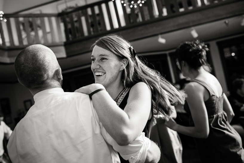 Groom dances with guest at Chautauqua Community House wedding. Photography by Denver wedding photojournalist.