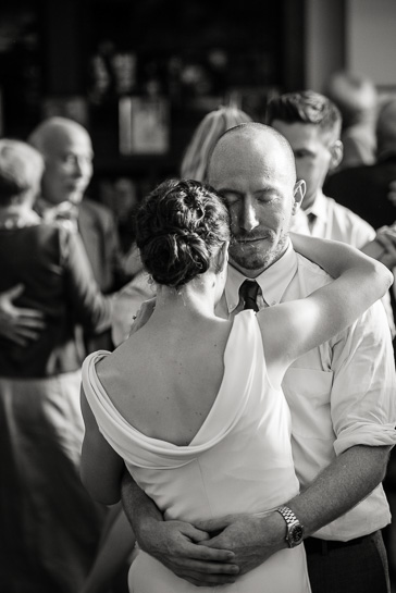 Documentary wedding photographer in Denver captures couple dancing at wedding reception.