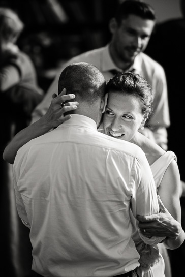 Bride holds groom while dancing at Chautauqua Community House wedding.