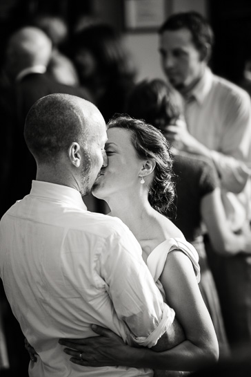 Bride kisses groom on dance floor at Boulder wedding reception site.