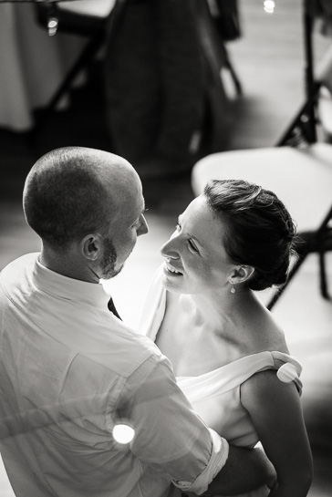 Bride smiles at groom on dance floor of Boulder wedding reception.