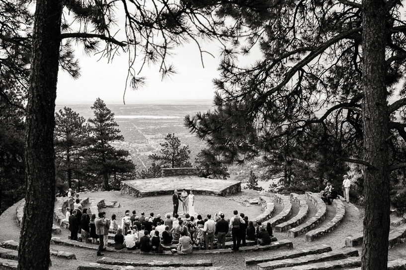 Couple gets married at Sunrise Amphitheater overlooking Boulder, Colorado.