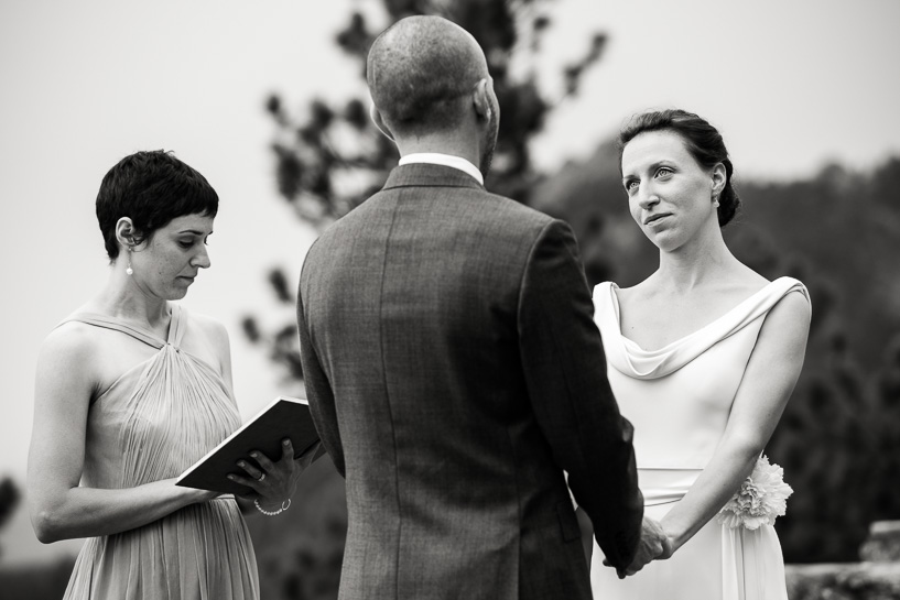 Bride and groom exchanging vows at Sunrise Amphitheater wedding in Boulder, Colorado.