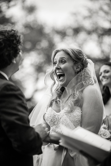Surprised bride during ceremony by Denver black and white documentary wedding photographer.