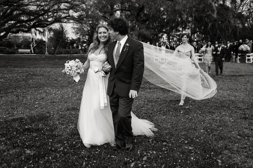 New Orleans bride with long train by Denver wedding photojournalist.