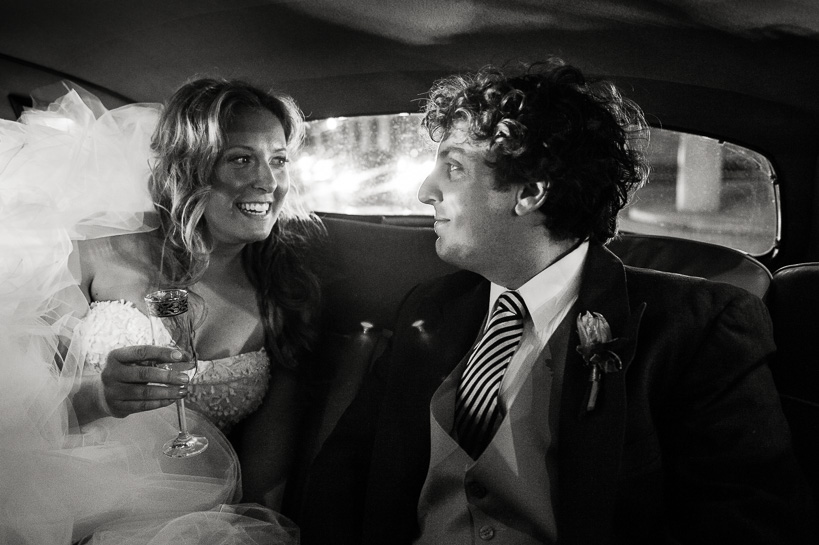 New Orleans bride and groom in the back of their limo.