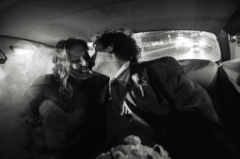 Denver wedding photographer captures kiss in the back of the limo at a New Orleans wedding.