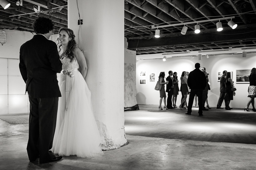 Wedding couple hide from guests before their reception.