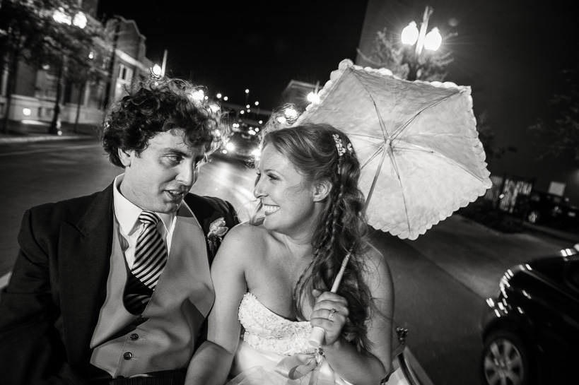 Bride and groom in a horse-drawn carriage in the streets of New Orleans.