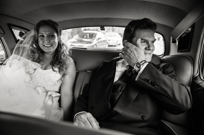 Denver wedding photojournalist captures bride and her father in the back of the limo.
