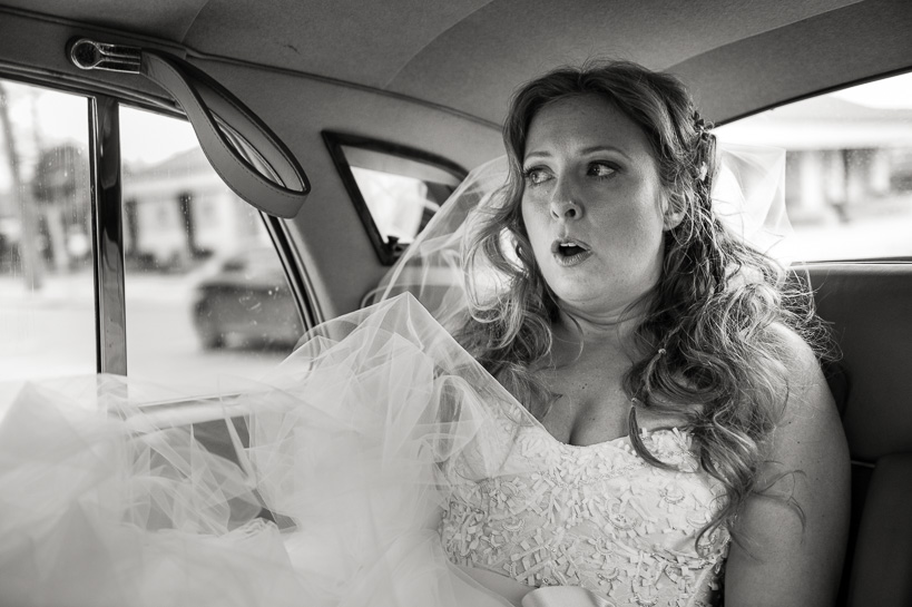 Denver documentary wedding photographer captures nervous bride in the back of her limo.