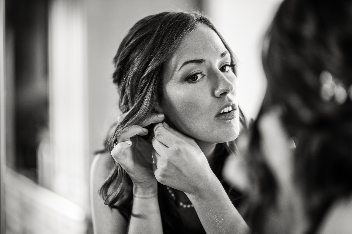 Colorado bride prepares at her father's house for a Longmont wedding.