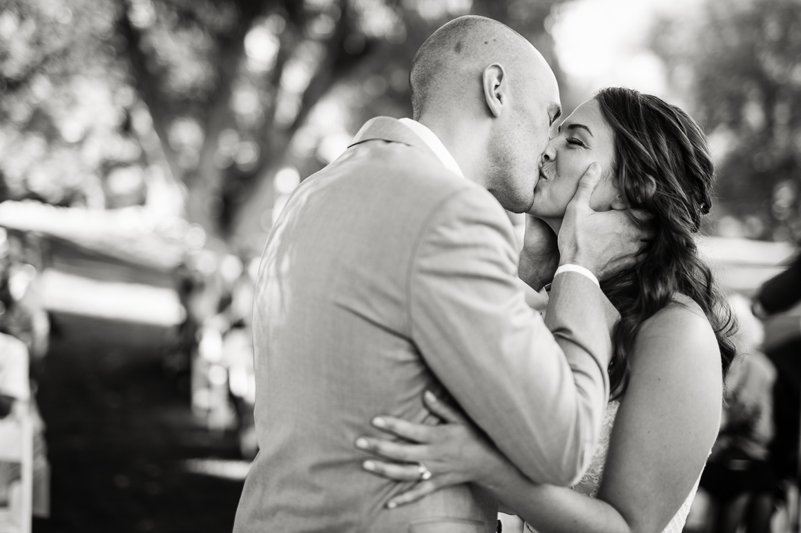 Colorado bride and groom kiss following a Longmont wedding ceremony.