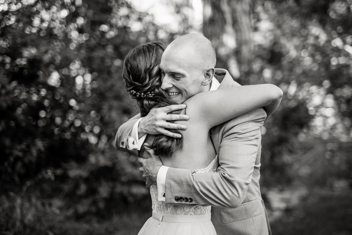 Bride and groom embrace after a Longmont Colorado wedding ceremony.