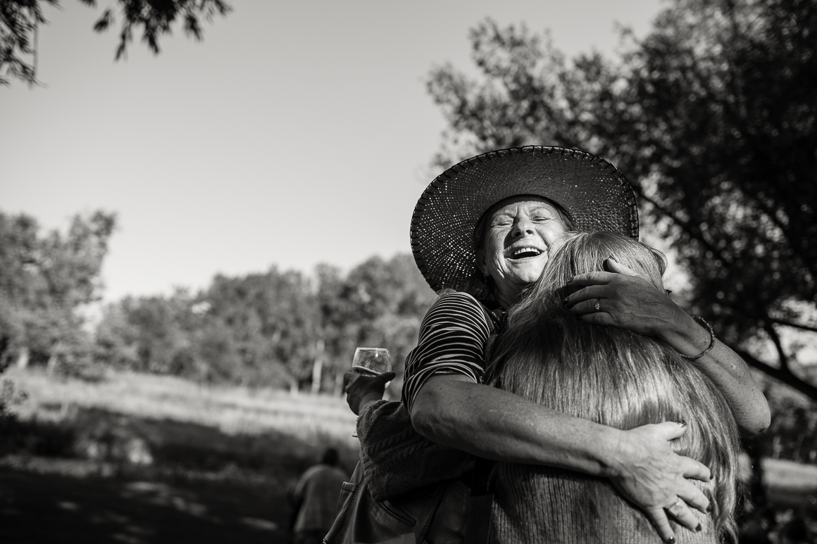 Family members embrace at a Colorado country wedding.