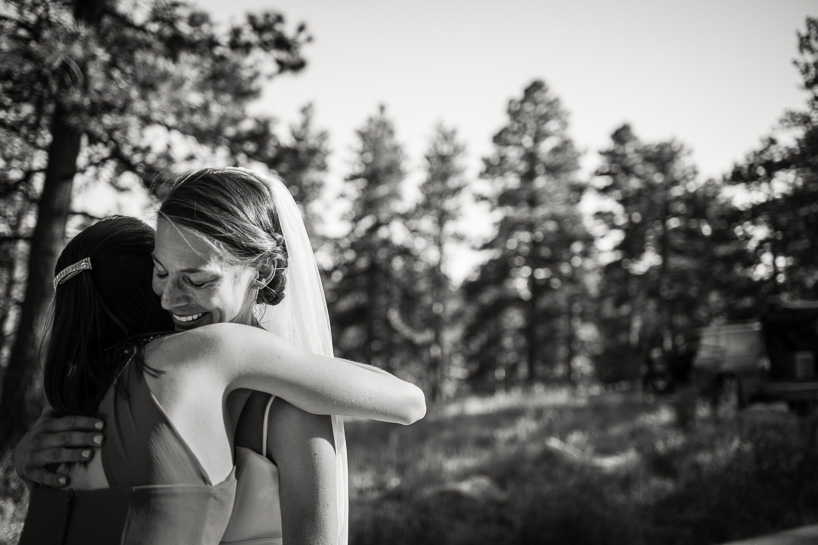 Bride with maid of honor on Flagstaff Mountain in Boulder