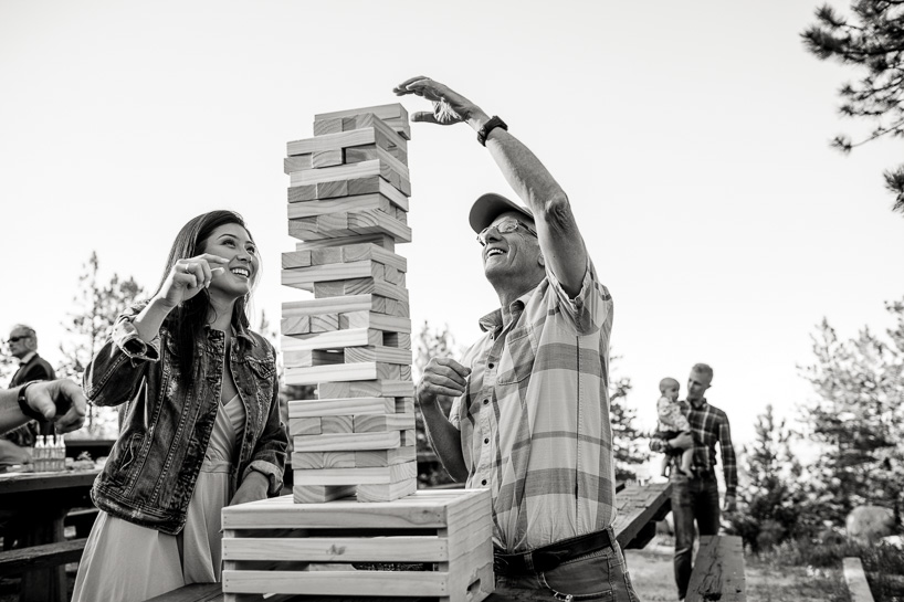 wedding guests play jenga near Sunrise Amphitheater