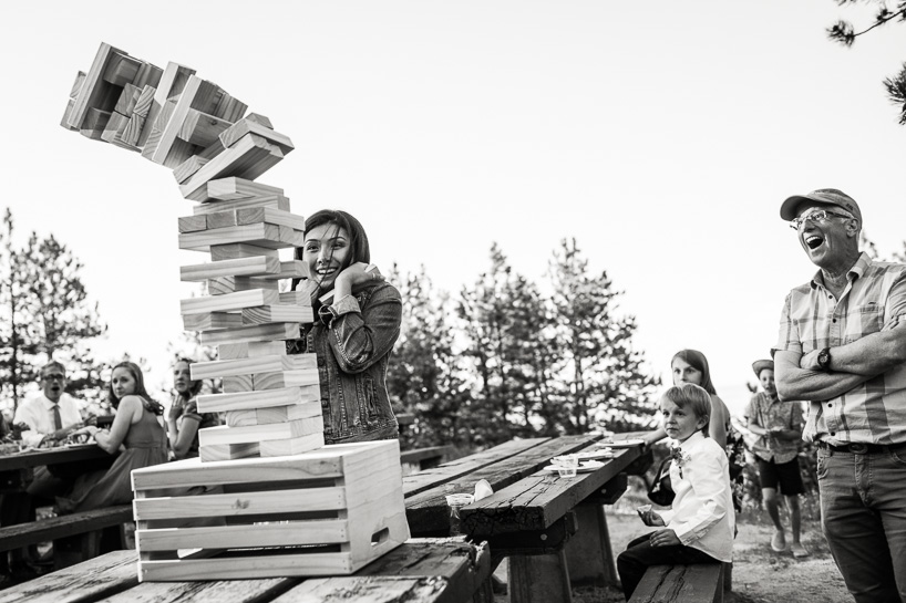 Jenga blocks collaspse at wedding reception by Denver wedding photojournalist