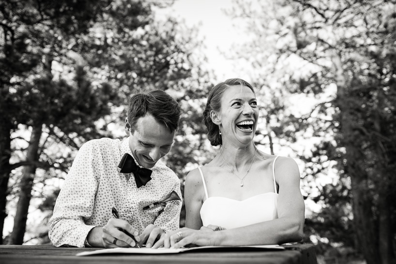 groom and bride signing marriage license at Boulder wedding