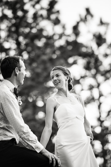 candid black and white image of wedding couple outdoors