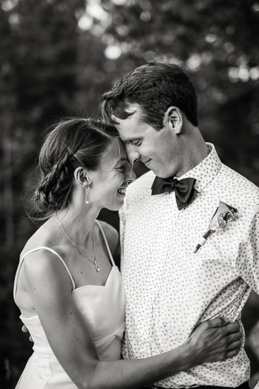 Couple at reception by Denver wedding photojournalist