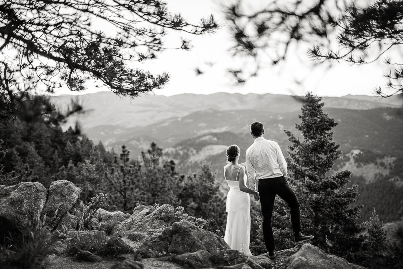 Boulder bride and groom watching sun set at Colorado mountain wedding
