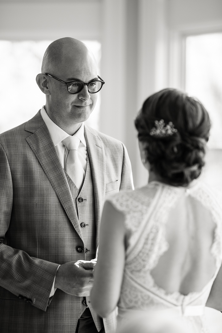 black and white high key image of wedding vows by Denver wedding photographer