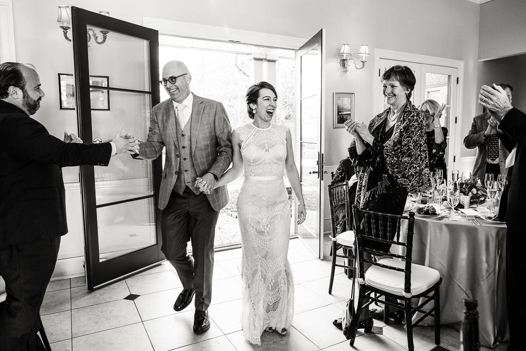 Denver wedding photographer's image of couple entering reception.